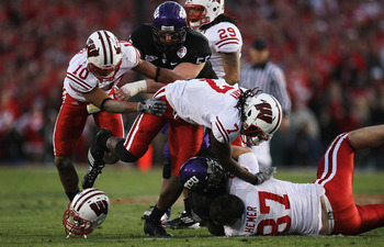 PASADENA, CA - JANUARY 01:  Wide receiver Jeremy Kerley #85 of the TCU Horned Frogs is tackled after a catch against the Wisconsin Badgers in the 97th Rose Bowl game on January 1, 2011 in Pasadena, California.  (Photo by Stephen Dunn/Getty Images)