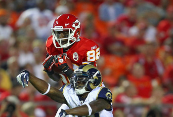 KANSAS CITY, MO - AUGUST 26: Dwayne Bowe #82 of the Kansas City Chiefs hauls in a pass against Quintin Mikell #27 of the St. Louis Rams during a pre-season game at Arrowhead Stadium  on August 26, 2011 in Kansas City, Missouri.  (Photo by Dilip Vishwanat/
