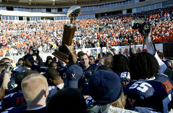 CHARLOTTE, NC - DECEMBER 27:  Matt Schaub #7 of the Virginia Cavaliers is surrounded by his team as they lift the trophy after defeating the Pittsburgh Panthers during the Continental Tire Bowl December 27, 2003 at Ericsson Stadium in Charlotte, North Car