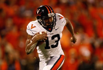 CLEMSON, SC - NOVEMBER 21:  Chase Minnifield #13 of the Virginia Cavaliers runs with the ball during the game against the Clemson Tigers at Memorial Stadium on November 21, 2009 in Clemson, South Carolina.  (Photo by Streeter Lecka/Getty Images)