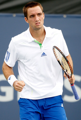 MONTREAL, QC - AUGUST 09:  Viktor Troicki of Serbia celebrates a point aganst Michael Yani of the United States during the Rogers Cup at Uniprix Stadium on August 9, 2011 in Montreal, Canada.  (Photo by Matthew Stockman/Getty Images)
