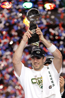 Aaron Rodgers with Lombardi Trophy