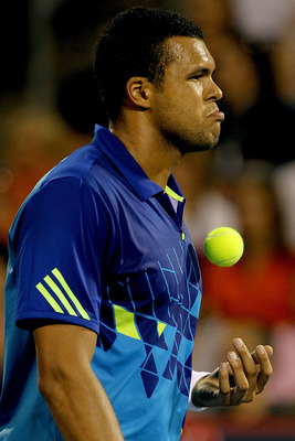 MONTREAL, QC - AUGUST 13:  Jo-Wilfried Tsonga of France walks back to the baseline after loosing a point Novak Djokovic of Serbia during the Rogers Cup at Uniprix Stadium on August 13, 2011 in Montreal, Canada.  (Photo by Matthew Stockman/Getty Images)