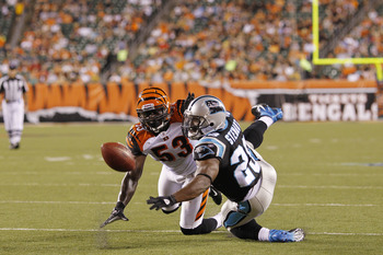 CINCINNATI, OH - AUGUST 25: Thomas Howard #53 of the Cincinnati Bengals defends a pass intended for Jonathan Stewart #28 of the Carolina Panthers during an NFL preseason game at Paul Brown Stadium on August 25, 2011 in Cincinnati, Ohio. The Bengals won 24