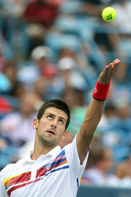 MASON, OH - AUGUST 20:  Novak Djokovic of Serbia serves the ball to Tomas Berdych during the Western & Southern Open at the Lindner Family Tennis Center on August 20, 2011 in Mason, Ohio.  (Photo by Elsa/Getty Images)