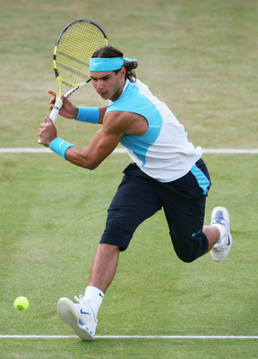 LONDON - JUNE 15:  Rafael Nadal of Spain hits a backhand during the singles quarter final match against Nicolas Mahut of France during Day 5 of the Artois Championships at The Queen's Club on June 15, 2007 in London, England.  (Photo by Julian Finney/Gett