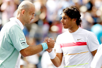 INDIAN WELLS, CA - MARCH 20:  Ivan Ljubicic (L) of Croatia is congratulated at the net by Rafael Nadal of Spain after their match during the semifinals of the BNP Paribas Open on March 20, 2010 at the Indian Wells Tennis Garden in Indian Wells, California