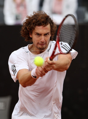 ROME - MAY 01:  Ernests Gulbis of Latvia plays a backhand in his match against Rafael Nadal of Spain serves to  during day seven of the ATP Masters Series - Rome at the Foro Italico Tennis Centre on May 1, 2010 in Rome, Italy.  (Photo by Julian Finney/Get
