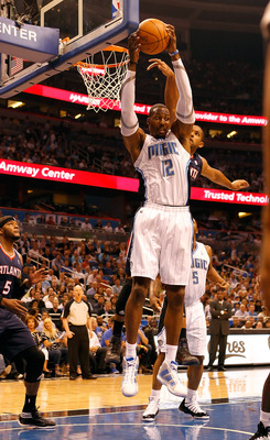 ORLANDO, FL - APRIL 26:  Dwight Howard #12 of the Orlando Magic rebounds against the Atlanta Hawks during Game Five of the Eastern Conference Quarterfinals of the 2011 NBA Playoffs on April 26, 2011 at the Amway Arena in Orlando, Florida.  NOTE TO USER: U