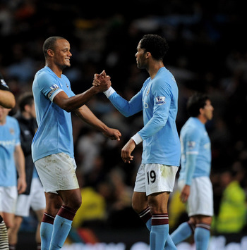 MANCHESTER, ENGLAND - MAY 10:  Joe Hart (L), Vincent Kompany and Joleon Lescott (R) of Manchester City celebrate at the end of the Barclays Premier League match between Manchester City and Tottenham Hotspur at the City of Manchester Stadium on May 10, 201