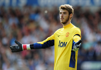WEST BROMWICH, ENGLAND - AUGUST 14:  David De Gea of Manchester United gestures during the Barclays Premier League match between West Bromwich Albion and Manchester United at The Hawthorns on August 14, 2011 in West Bromwich, England.  (Photo by Shaun Bot