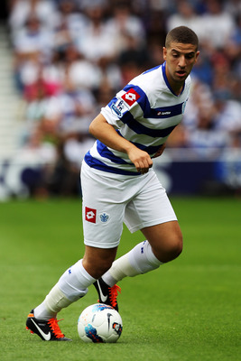 LONDON, ENGLAND - AUGUST 13:  Adel Taarabt of Queens Park Rangers in action during the Barclays Premier League match between Queens Park Rangers and Bolton Wanderers at Loftus Road on August 13, 2011 in London, England.  (Photo by Michael Steele/Getty Ima