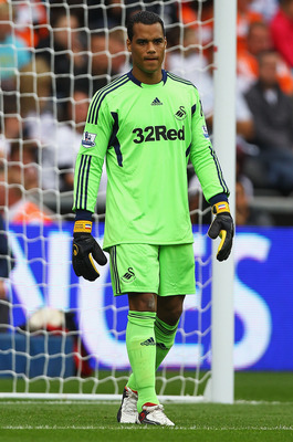 SWANSEA, WALES - AUGUST 20:  Michael Vorm of Swansea City in action during the Barclays Premier League match between Swansea City and Wigan Athletic at Liberty Stadium on August 20, 2011 in Swansea, Wales.  (Photo by Matthew Lewis/Getty Images)