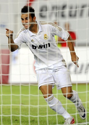 GUANGZHOU, CHINA - AUGUST 03:  Jese Rodriguez of Real Madrid celebrates after scoring a goal during the pre-season friendly match between Guangzhou Evergrande and Real Madrid at the Tianhe Stadium on August 3, 2011 in Guangzhou, China.  (Photo by Victor F