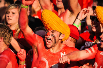 LINCOLN, NE - OCTOBER 16: Fans of the Nebraska Cornhuskers react after fourth a quarter punt return for a touchdown of their game against the Texas Longhorns at Memorial Stadium on October 16, 2010 in Lincoln, Nebraska. Texas Defeated Nebraska 20-13. (Pho