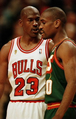 7 Jun 1996:   Michael Jordan of the Chicago Bulls and Gary Payton of the Seattle Supersonics exchange words during the final seconds of game two in the NBA Finals at the United Center in Chicago. The two players had to be separated by teammates and refere