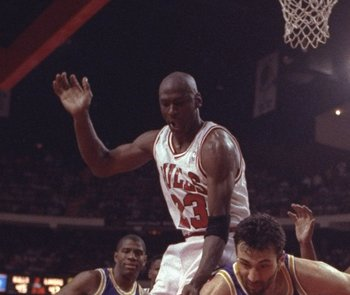2 May 1991:  Guard Michael Jordan of the Chicago Bulls (center) lands on a Los Angeles Lakers player during Game One of the NBA finals at the United Center in Chicago, Illinois.  The Lakers won the game, 93-91. Mandatory Credit: Jonathan Daniel  /Allsport
