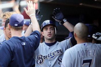 NEW YORK, NY - AUGUST 21:  Ryan Braun #8 of the Milwaukee Brewers celebrates in the dugout after scoring an eighth inning run against the New York Mets at Citi Field on August 21, 2011 in the Flushing neighborhood of the Queens borough of New York City. T