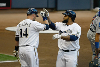 MILWAUKEE, WI - AUGUST 27: Prince Fielder #28 of the Milwaukee Brewers is congratulated by Casey McGehee #14 after hitting a home run during the game against the Chicago Cubs at Miller Park on August 27, 2011 in Milwaukee, Wisconsin. The Brewers defeated