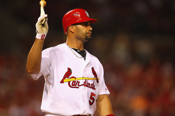 ST. LOUIS, MO - AUGUST 23: Albert Pujols #5 of the St. Louis Cardinals reacts to hitting an inning-ending line drive against the Dodgers at Busch Stadium on August 23, 2011 in St. Louis, Missouri.  (Photo by Dilip Vishwanat/Getty Images)