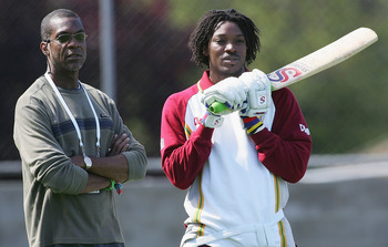 HOBART, TAS - NOVEMBER 16:  (L-R) Former West Indies bowling great Michael Holding talks with Chris Gayle of the West Indies during training at Bellerive Oval on November 16, 2005 in Hobart, Australia.  (Photo by Hamish Blair/Getty Images)