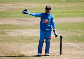 HOVE, ENGLAND - AUGUST 25: MS Dhoni of India gestures to his fielders during the one day tour match between Sussex and India at The County Ground on August 25, 2011 in Hove, England.  (Photo by Harry Engels/Getty Images)