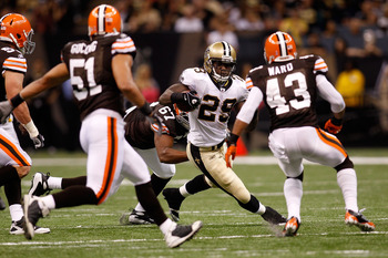 NEW ORLEANS - OCTOBER 24:  Chris Ivory #29 of the New Orleans Saints avoids a tackle by Derreck Robinson #67 and T.J. Ward #43 of the Cleveland Browns at the Louisiana Superdome on October 24, 2010 in New Orleans, Louisiana.  (Photo by Chris Graythen/Gett