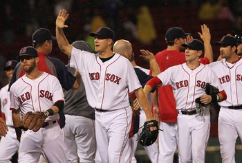 BOSTON, MA - AUGUST 27:  Jonathan Papelbon #58 of the Boston Red Sox and teammates celebrate a 4-0 win over the Oakland Athletics at Fenway Park August 27, 2011 in Boston, Massachusetts. (Photo by Jim Rogash/Getty Images)