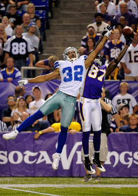 MINNEAPOLIS, MN - AUGUST 27: Orlando Scandrick #32 of the Dallas Cowboys breaks up a pass intended for Bernard Berrian #87 of the Minnesota Vikings in the first half on August 27, 2011 at Hubert H. Humphrey Metrodome in Minneapolis, Minnesota. (Photo by H