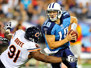 NASHVILLE, TN - AUGUST 27:  Jake Locker #10 of the Tennessee Titans is sacked by Amobi Okoye #91 of the Chicago Bears during a preseason game at LP Field on August 27, 2011 in Nashville, Tennessee. Tennessee defeated Chicago, 14-13.  (Photo by Grant Halve