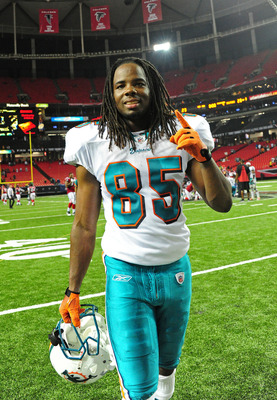 ATLANTA - AUGUST 12: Phillip Livas #85 of the Miami Dolphins celebrates after a preseason game against the Atlanta Flacons at the Georgia Dome on August 12, 2011 in Atlanta, Georgia. (Photo by Scott Cunningham/Getty Images)