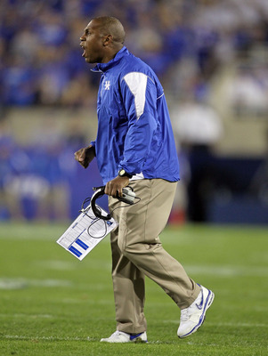 LEXINGTON, KY - OCTOBER 09: Joker Phillips the Head Coach of the Kentucky Wildcats gives instructions to his team during the SEC game against  the Auburn Tigers  at Commonwealth Stadium on October 9, 2010 in Lexington, Kentucky.  (Photo by Andy Lyons/Gett