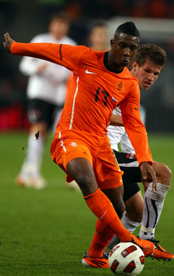 EINDHOVEN, NETHERLANDS - FEBRUARY 09:  Eljero Elia of The Netherlands goes past Franz Schiemer of Austria during the International Friendly match between The Netherlands and Austria at the Phillips Stadion on February 9, 2011 in Eindhoven, Netherlands.  (