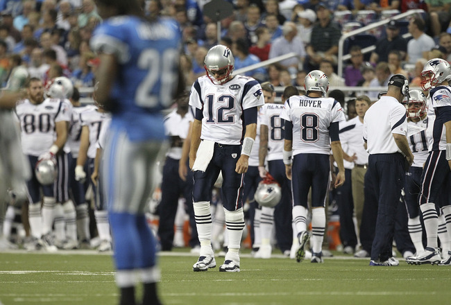 DETROIT - AUGUST 27:  Quarterback Tom Brady #12 of the New England Patriots walks back to the huddle during the first quarter of the game against the Detroit Lions at Ford Field on August 27, 2011 in Detroit, Michigan.  (Photo by Leon Halip/Getty Images)