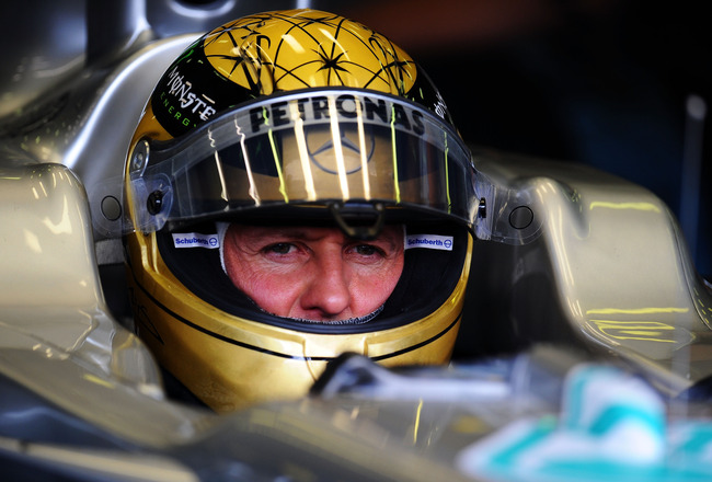 SPA FRANCORCHAMPS, BELGIUM - AUGUST 26:  Michael Schumacher of Germany and Mercedes GP prepares to drive wearing a specially designed gold drivers helmet as he commemorates the 20th anniversary of his first F1 race during practice for the Belgian Formula