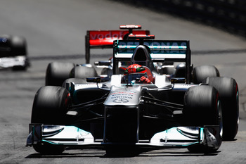 Michael Schumacher battling with Lewis Hamilton in Monaco's narrow and mean streets.