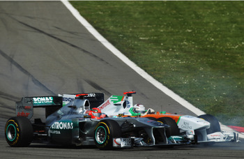 ISTANBUL, TURKEY - MAY 08:  Michael Schumacher (left) of Germany and Mercedes GP and Adrian Sutil (right) of Germany and Force India drive side by side during the Turkish Formula One Grand Prix at the Istanbul Park circuit on May 8, 2011 in Istanbul, Turk