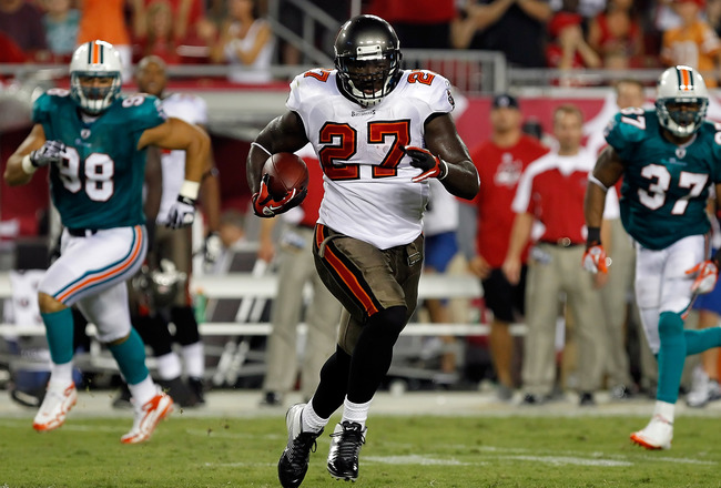 TAMPA, FL - AUGUST 27:  Running back LeGarrette Blount #27 of the Tampa Bay Buccaneers breaks into the open against the Miami Dolphins during a preseason game at Raymond James Stadium on August 27, 2011 in Tampa, Florida.  (Photo by J. Meric/Getty Images)