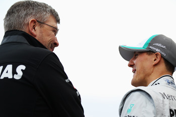 VALENCIA, SPAIN - FEBRUARY 01:  Michael Schumacher (R) of Germany and Mercedes GP talks with Mercedes GP Team Principal Ross Brawn (L) as they attend the launch of the new Mercedes MGP W02 at the Ricardo Tormo Circuit on February 1, 2011 in Valencia, Spai