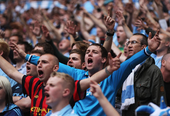 LONDON, ENGLAND - AUGUST 07:  Manchester City fans support their team during the FA Community Shield match sponsored by McDonald's between Manchester City and Manchester United at Wembley Stadium on August 7, 2011 in London, England.  (Photo by Clive Rose