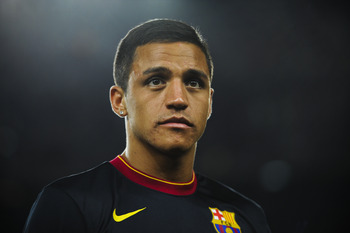 BARCELONA, SPAIN - AUGUST 22:  Alexis Sanchez of FC Barcelona looks on at the end of the Joan Gamper Trophy match between FC Barcelona and SSC Napoli at the Camp Nou Stadium on August 22, 2011 in Barcelona, Spain.  (Photo by David Ramos/Getty Images)