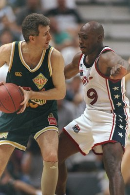 12 Jul 1996:  Mitch Richmond of Dream Team III, right, closely guards Andrew Gaze of Australia during the USA's 118-77 victory over Australia at the Delta Center in Salt Lake City, Utah. Mandatory Credit: Jed Jacobsohn  /Allsport