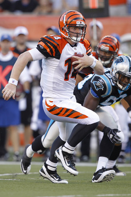 CINCINNATI, OH - AUGUST 25: Andy Dalton #14 of the Cincinnati Bengals runs with the ball in the first half of an NFL preseason game against the Carolina Panthers at Paul Brown Stadium on August 25, 2011 in Cincinnati, Ohio. (Photo by Joe Robbins/Getty Ima