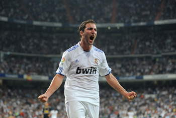 MADRID, SPAIN - SEPTEMBER 21: Gonzalo Higuain  of Real Madrid celebrates scoring Real's second goal during the La Liga match between Real Madrid and Espanyol at Estadio Santiago Bernabeu on September 21, 2010 in Madrid, Spain.  (Photo by Denis Doyle/Getty