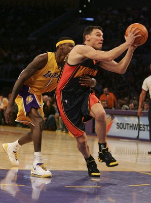 LOS ANGELES - JANUARY 22:  Sarunas Jasikevicius #33 of the Golden State Warriors dribbles the ball around Smush Parker #1 of the Los Angeles Lakers in the first half of the game at the Staples Center January 22, 2007 in Los Angeles, California. NOTE TO US