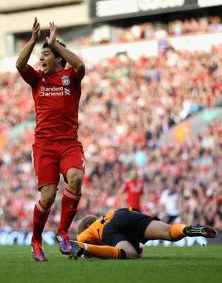 LIVERPOOL, ENGLAND - AUGUST 27:  Luis Suarez of Liverpool appeals for handball during the Barclays Premier League match between Liverpool and Bolton Wanderers at Anfield on August 27, 2011 in Liverpool, England.  (Photo by Clive Brunskill/Getty Images)
