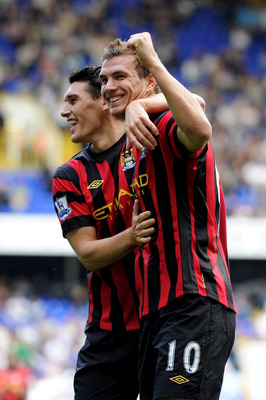 LONDON, ENGLAND - AUGUST 28:  Edin Dzeko (R) of Manchester City celebrates scoring his fourth goal with teammate Gareth Barry during the Barclays Premier League match between Tottenham Hotspur and Manchester City at White Hart Lane on August 28, 2011 in L