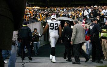 PITTSBURGH, PA - NOVEMBER 21:  Richard Seymour #92 of the Oakland Raiders is escorted out of the stadium after being ejected for hitting Ben Roethlisberger #7 of the Pittsburgh Steelers during the game on November 21, 2010 at Heinz Field in Pittsburgh, Pe