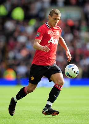 WEST BROMWICH, ENGLAND - AUGUST 14: Nemanja Vidic of Manchester United in action during the Barclays Premier League match between West Bromwich Albion and Manchester United at The Hawthorns on August 14, 2011 in West Bromwich, England.  (Photo by Shaun Bo