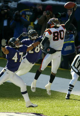 Top Fantasy rookie WR Peter Warrick stretches for a TD grab against Baltimore.